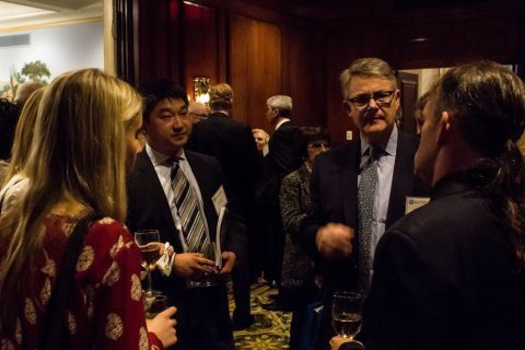 John Stewart speaks with NCAFP members and guests after the panel
