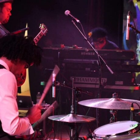 Soulive playing 'Come Together' at v3